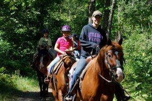 a family riding horses
