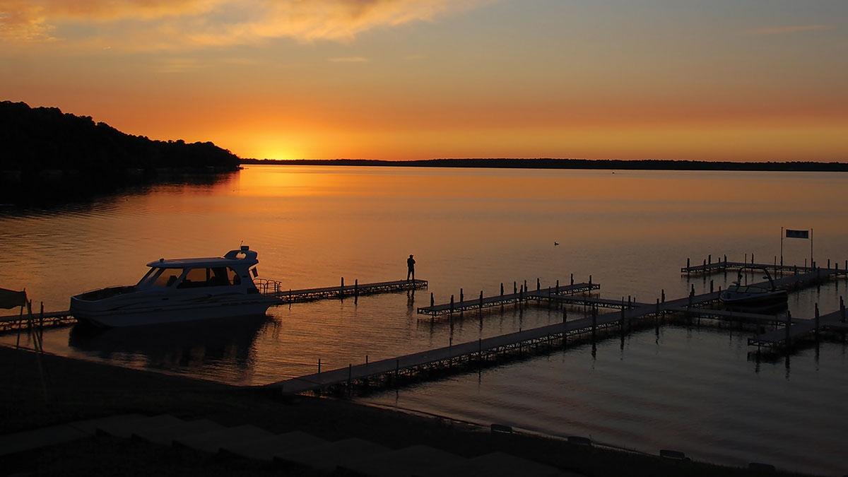 sunset at the quarterdeck resort beach