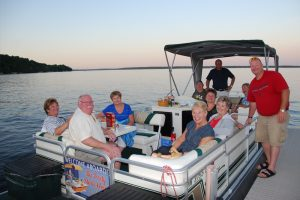 A group of people on the pontoon at Quarterdeck Resort