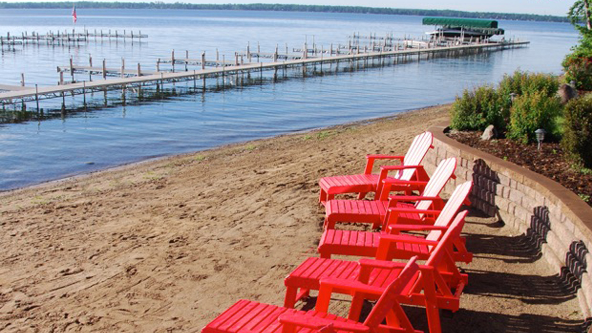 five red chairs at the quarterdeck resort beach