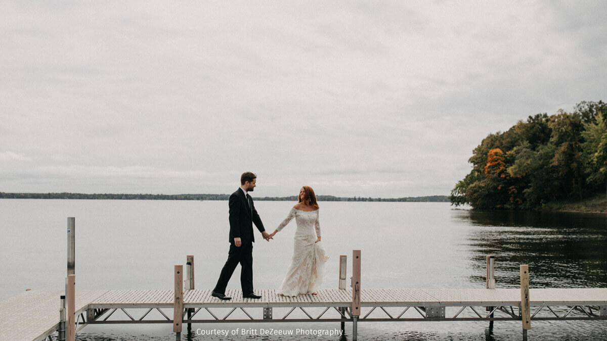 a groom and  his bride on the dock at quarterdeck resort