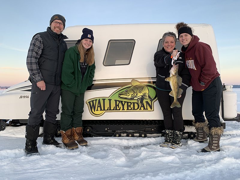 a family ice fishing